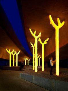 Australian artist Warren Langley's trees light up a underpass in Sydney. Click…