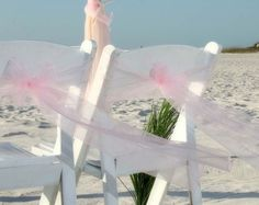 Blush sashes dance in the breeze