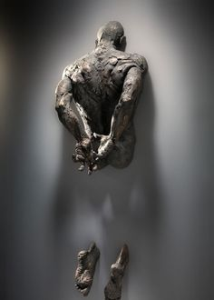 Sculptures Emerge from Walls