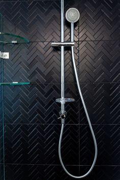 black tiles bathroom herringbone tile