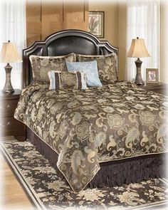 """Blue Brown Queen TOB Set - Signature Design by Ashley Furniture by Ashley. $210.74. 2 Standard Shams. 1 Comforter. 1 Skirt. 7 pc TOB ensemble. 7 pc TOB ensemble. 1 Comforter. 1 Skirt. 2 Standard Shams. 3 Accent pillows. DRY CLEAN ONLY. Dimensions:Inches: 92 W x 96 D16.1/7.303 Metric: 2336.8mm W x 2438.4mm D More Dimensions: Accent Pillow #1 18"""" x 18"""" Accent Pillow #2 17"""" x 17"""" Accent Pillow #3 12"""" x 19"""" Skirt 60""""W x 80""""D Standard Shams 26""""W x 20""""D Some assembly may be required...."""