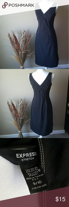 Express Stretch Dress Black with cream colored stitching. Dress is brand new. Size is 9/10 but will fit up to a size 12. Zips down the side under your arm. Very pretty dress would be perfect for date night or the office! Express Dresses Midi
