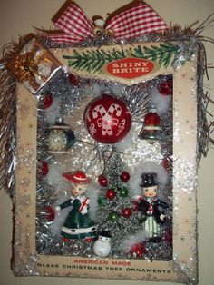Using a vintage shiny brite box as a window box and creating a little Christmas scene to hang on the wall