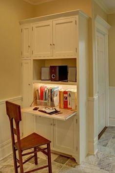 Built in kitchen desk for cookbooks, file storage, sound system.  Broom closet in cabinet at left.  Kitchen by Tracey Stephens Interior Design, Inc.