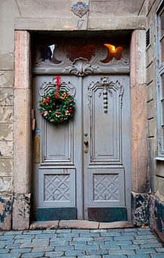 Christmas wreath hanging on door in Stockholm, Sweden