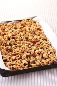 Granola {Without Oil} Ingredients 4 cups whole oats (DON'T use quick oats) 1 cup sliced or slivered almonds 1/2 cup packed light-brown sugar 1/4 cup honey 2 Tbsp water 1 1/4 tsp ground cinnamon 1 pinch ground nutmeg 1/2 tsp salt 1 tsp vanilla extract 1/4 tsp baking soda 1 cup dried berries such as blueberries, cranberries, or raisins*, optional