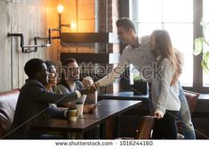 Happy couple getting acquainted with multiracial people coming at meeting in cafe, young man introducing handshaking african guy from various friends group, new acquaintance and making first impression New Relationships, Relationship Advice, College Boyfriend, Gangster Films, Separate Ways, Single Dating, Find People, New City, Make New Friends