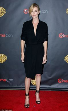 Back in black: Charlize Theron arrived at CinemaCon in Las Vegas on Tuesday...