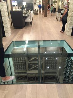with the door to this wine cellar so seamlessly blended into the