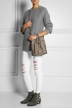 Chinti and Parker | Lattice and cable-knit merino wool sweater, Frame Denim jeans, Toga Pulla boots, and 3.1 Phillip Lim bag.