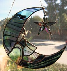 Stained Glass Man in Moon & Star Suncatcher is in Irridized Black Baroque Glass