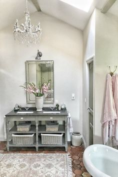 The renovated bathroom in this country house near Bordeaux by Vivi et Margot feels authentic and original. #bathroomdesign #frenchcountry #oldworldstyle #frenchhome #romanticbathroom
