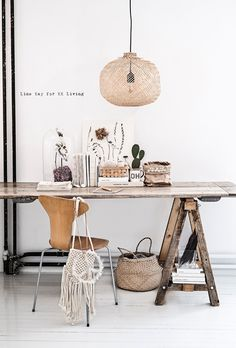 For a cohesive look, pair vintage sawhorses with a salvaged wood top, as shown on the desk above from Vintage Piken for KK Living.