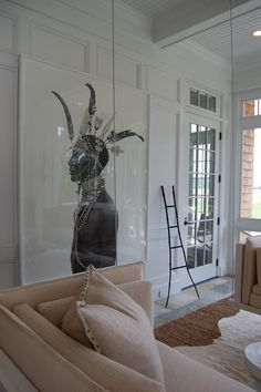ABOUT FACE: portraiture in the contemporary interior.  Screened porch designed by Brad Ford for Traditional Home's Hampton Designer Show House. Tribesman photo by Lyle Owerko via Clic Gallery. Photo via Habitually Chic.