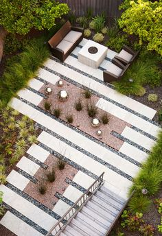 Garden. pavers with bands of beach pebble stone