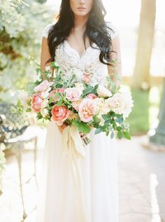 Summer bridal bouquet with dahlias, garden roses, yarrow, blueberries and honeysuckle. Photo: Elyse Alexandria