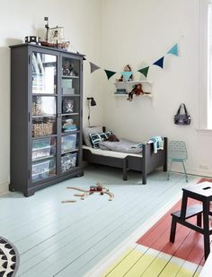 Love the different colors on the floor, the garland and the beautiful armoire. #kids #decor