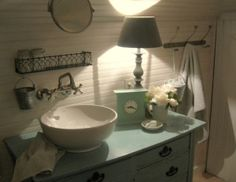 Love the robin's egg blue dresser/vanity and the sideways beadboard by Bren G