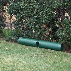 """Stuff straw in one end of 12"""" PVC pipe for wind and rain proof stray or feral cat shelter"""