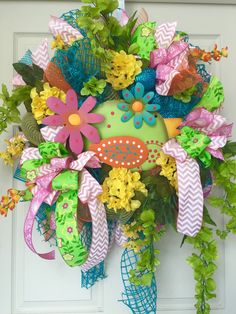 Colorful Spring and Summer Mesh Wreath  by WilliamsFloral on Etsy https://www.etsy.com/listing/227915117/colorful-spring-and-summer-mesh-wreath