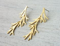 Delicate long post earrings with a botanic touch, inspired by Scandinavian design. A bare branch element is soldered to a sterling silver ear rod.