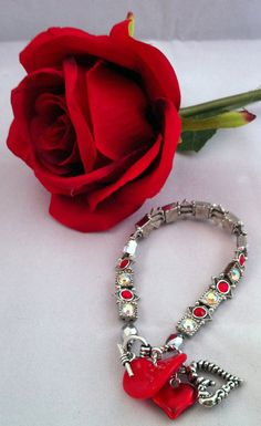 Red and clear charmed bracelet by Bitz2Glitz on Etsy, $15.00