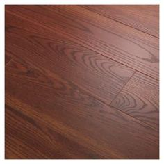 Auburn Laminate Flooring  Made of fiberboard that is covered with a photo reproduction of wood grain or other material. a top layer of plastic provides protection. they are installed as floating floors over a foam pad. They resist dents and scratches and are comfortable to stand on. also very durable. one downside is they have almost a fake look to them compared to wood floors.