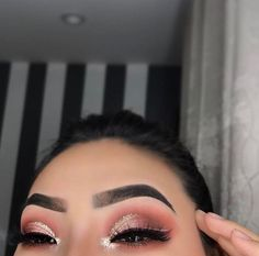 Ombre pink with gold glitter cut crease and perfect brows