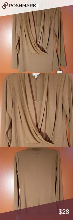 NWT eci New York Knit Top Beautiful silky feeling one piece top, stretchy. Made of 95% polyester and 5% spandex. eci New York Tops Blouses