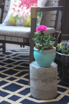 So lovely and understated... but with a big impact. We love this hot pink potted geranium on the cement pillar. It adds just the right splash of color to this small patio styled by Chelsea Coulston of  Making Home Base. See more of her small patio decorating ideas on The Home Depot Blog. || @chelseacoulston