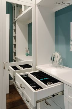 This Backless White Melamine Closet Pops Against Teal, While A Cabinet  Mirror Is Positioned Conveniently