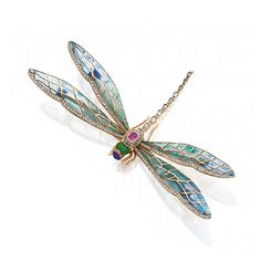 PLIQUE-À-JOUR ENAMEL, DIAMOND AND COLORED STONE DRAGONFLY BROOCH, CIRCA 1900. The delicate insect with blue and green plique-à-jour enamel wings, decorated further with a cabochon sapphire, oval pink sapphire, opaque green enamel and numerous rose-cut diamonds, mounted in gold and platinum.