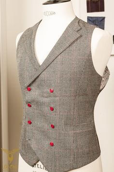 Double breasted 8-button waistcoat with notch lapels with a glen plaid check (glen Urquhart check/ Glenurquhart check) and red contrasting buttons. 10