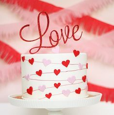 "Celebrating 14 Years in the Wedding Industry this Valentine's Day - Single Tier Heart Garland ""Love"" Wedding Cake from Kitty Wong Pastry Shop / as seen on www. Valentines Day Cakes, Valentine Desserts, Valentines Day Weddings, Fondant Cakes, Cupcake Cakes, Aniversary Cakes, Cake Decorating For Beginners, Pastry Shop, Love Cake"