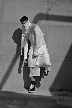 Paris-based Au Courant continuously blends elements of avant garde simplicity with the functionality and discipline exhibited in the wardrobes of the Far East. Model: Raphael Toureille.