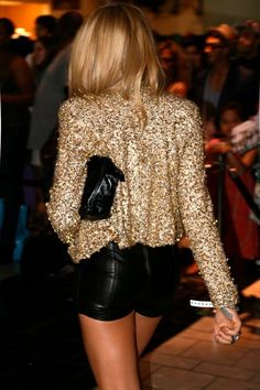 gold sequin blazer and black leather shorts.