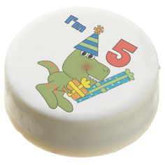 Little Dino 5thBirthday dipped Oreos and Oreo pops, a sweet treat for the birthday child and the guests at the celebration, also makes a fantastic take home party favor! Features a cute smiling dinosaur with gifts and text of blue and red that reads I'm 5! #kids #birthdays #dino #prehistoric #dinosaur #animals #fifth #five #5th birthday