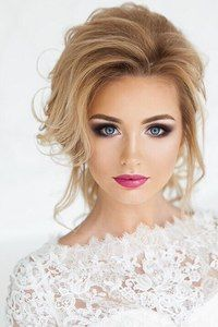 This is gorgeous hair and make up, I love the combo of the bright and smokey with the feminine undone updo.
