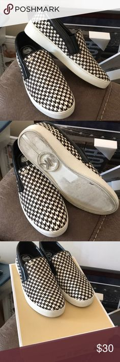 Michael Kors slip on sneakers Michael Kors slip on sneakers Like New.. worn only once  Upper is a printed hair in a black and white houndstooth pattern Michael Kors Shoes Sneakers