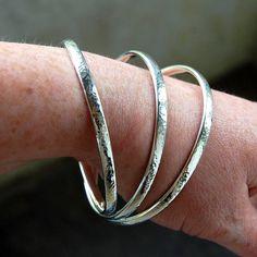Three handmade chunky silver bangles