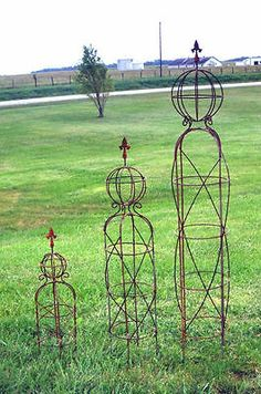 Our new design of Mystic Garden Obelisk topiaries support your plants with sturdy wrought iron. The Sphere tops off with a cast iron finial - a Obelisk Trellis, Arch Trellis, Metal Trellis, Garden Trellis, Plant Trellis, Vine Trellis, Trellis Ideas, Iron Pergola, Metal Pergola