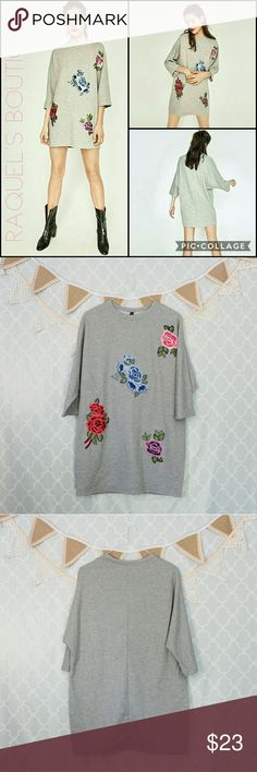 Grey Floral Sweatshirt Tunic Dress Details: Grey sweatshirt style tunic dress with 3/4 length sleeves and mixed colored rose appliques in the front   Brand: Boutique Brand  Size: Small Measurements: Bust/38-40 inches??? Length/30 inches  Size: Medium Measurements: Bust/41 inches??? Length/31 inches  Size: Large Measurements: Bust/42 inches??? Length/31.5 inches  Condition: New and packaged Dresses
