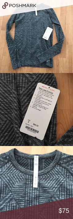 Lululemon Rest Less Pullover Cozy mid layer is perfect under your rain coat or ski jacket. Brushed fabric is soft against skin. Seamless construction. Thumbholes. Slim fit, hip length. Size 8. Black and Gray color combination. New with tags. lululemon athletica Tops Tees - Long Sleeve