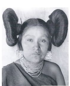Hoo-n-ym-pka (Hopi) taken in She wears turquoise mosaic earrings, a necklace of glass seed beads and a traditional black manta. Her butterfly hairstyle is typical of postpubescent, unmarried Hopi women.