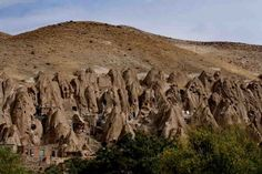 Kandovan is a mysterious thirteenth century village.near Osku and Tabriz, Iran Many of the homes at Kandovan have been made in caves located in cone-shaped, naturally formed compressed volcanic ash formations that make the landscape look like a gigantic termite colony. Most of the cave houses are two to four storeys in height.  #Iran