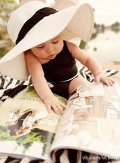 Baby reading. Cute.