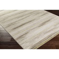 Anchor your dining room or master suite ensemble with this understated rug, featuring a simply-chic, abstract stripe motif in neutral tones. Let it define a stylish breakfast nook in the kitchen, or have it anchor your den ensemble in loft-worthy style.