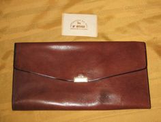 Check out this item in my Etsy shop https://www.etsy.com/listing/269035512/vintage-brown-leather-clutch-by-d-rivas