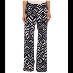 "Classy & Cozy Navy/White Palazzo Pants Glam meets comfort in the must-have Diamond Print Palazzo Pants Printed palazzo pant for ultimate comfort. Mid rise. Wide leg. Elasticized waist. Pull-on design. 96% polyester, 4% spandex. Inseam-32"" Brigitte Bailey Pants Wide Leg"