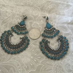 Beautiful earrings. Reminds me of peacocks. Stunning earrings with small accent pearls. The piece has never been worn. It reminds me of a peacock. They are for pierced ears. Jewelry Earrings